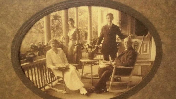 Mrs. Ursula Best, Emma Best, Dr. Duncan Best, and Dr. Christopher Best sit for a photo at their home, which was built in 1884