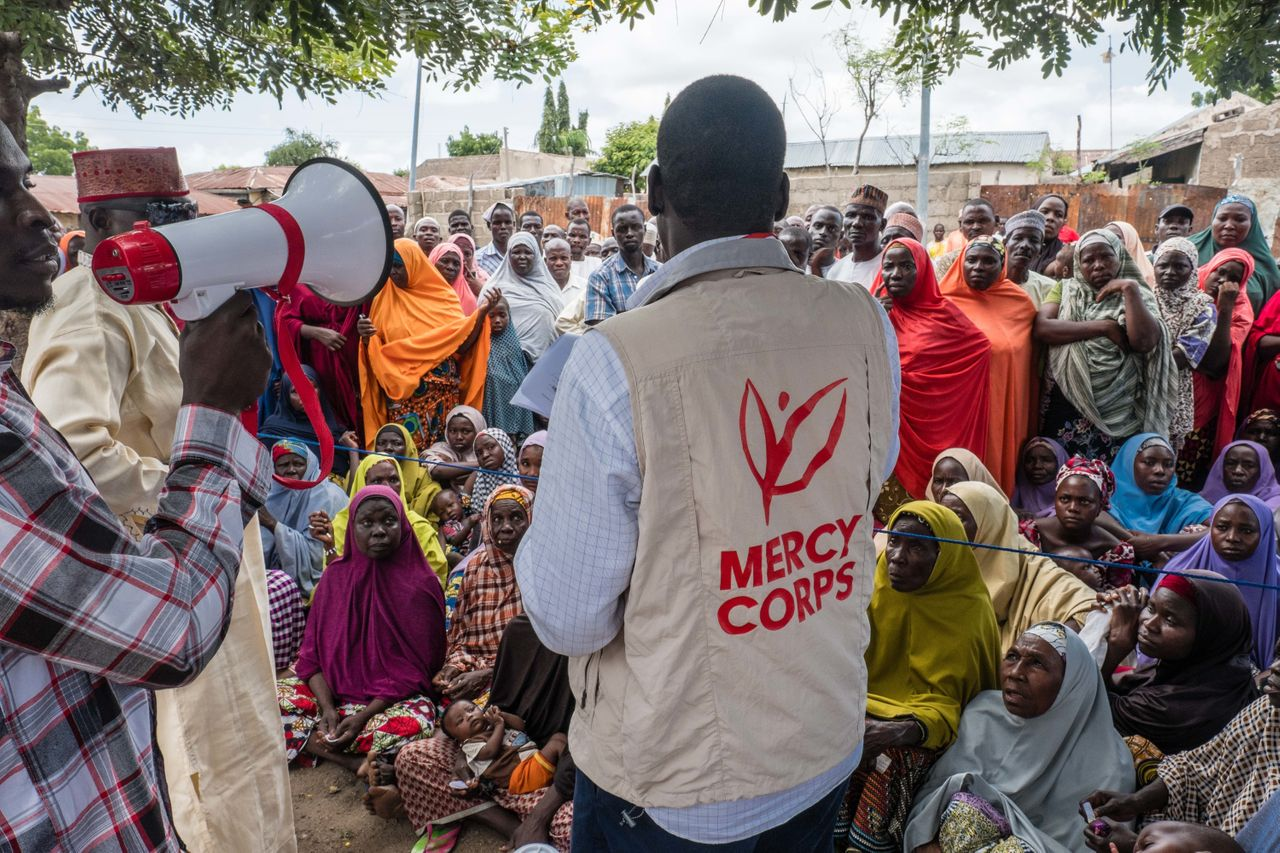 Mercy Corps distributes e-vouchers for food for the first time ever to internally displaced people in a neighborhood in Biu, Nigeria.