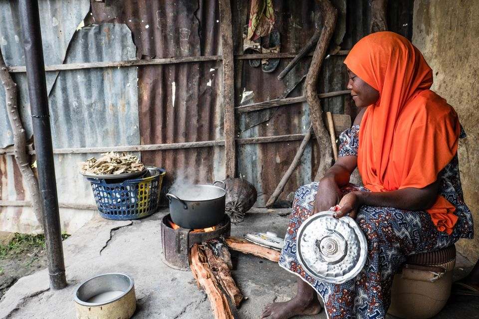 Habiba prepares a meal with food she bought at the market with a Mercy Corps food voucher. She was displaced by Boko Haram an