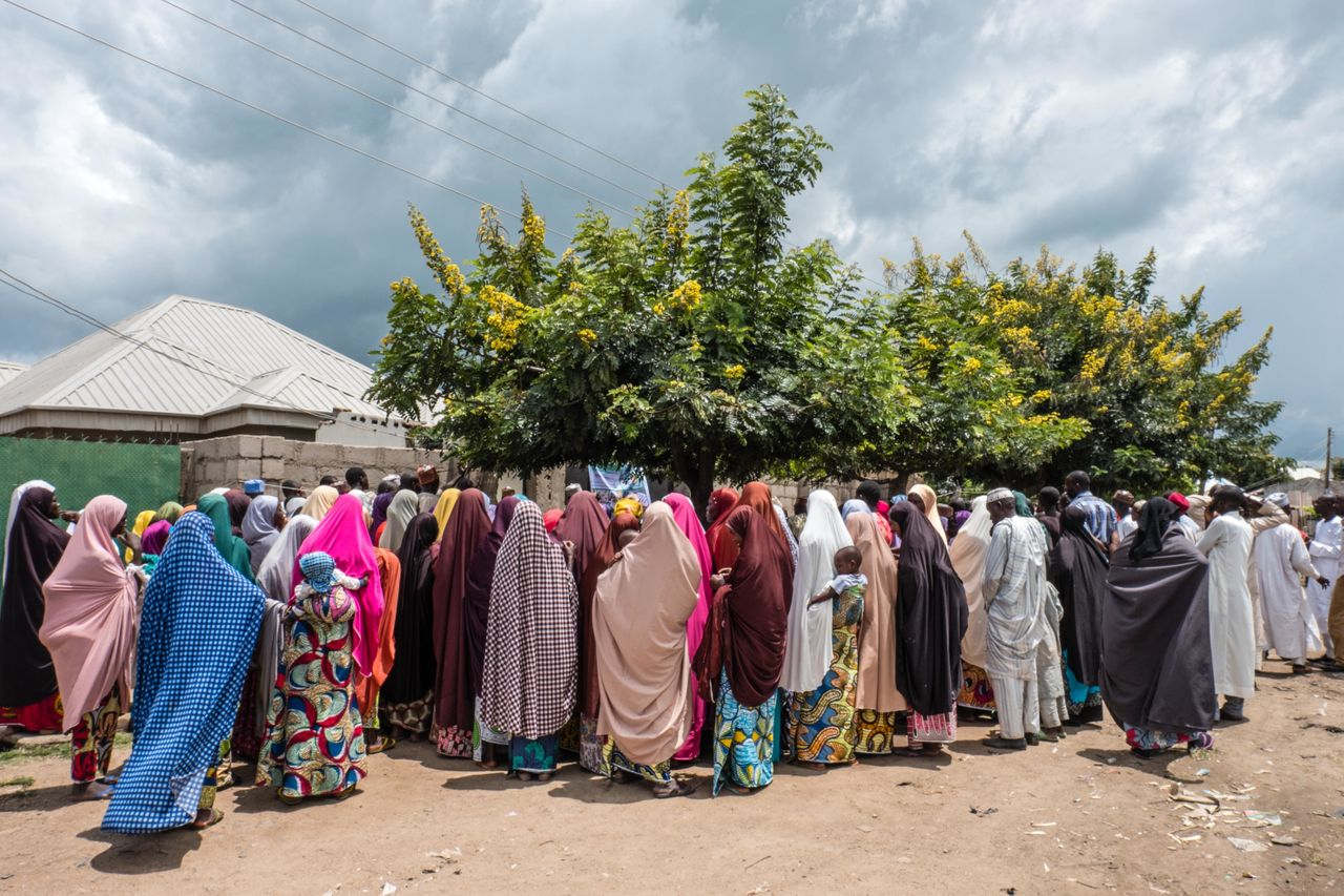 A crowd lines up to get Mercy Corps' e-vouchers in a neighborhood in Biu, Nigeria. The vouchers are worth 17,000 naira per month for eight months and can be used to buy food in local markets.