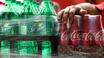 Cases of Coca-Cola Co. brand soda bottles are packaged for delivery in Miami Beach, Florida, U.S., on Monday, Oct. 24, 2016. The Coca-Cola Co. is scheduled to release earnings figures on October 26. Photographer: Scott McIntyre/Bloomberg via Getty Images