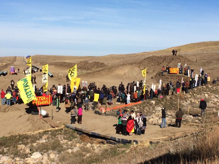 Protesters gather in Standing Rock, ND, at trench to protest the construction of the Dakota Access Pipeline.