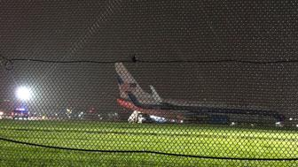 The plane that was carrying Republican vice presidential nominee Mike Pence sits on the runway at New York's LaGuardia Airport October 27, 2016 in New York. Republican vice presidential candidate Mike Pence's campaign plane slid off a runway after landing at New York's LaGuardia Airport in the  evening, the campaign said. No injuries were reported. / AFP / Don EMMERT        (Photo credit should read DON EMMERT/AFP/Getty Images)