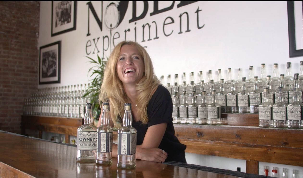 Bridget Firtle stands behind the bar at Noble Experiment