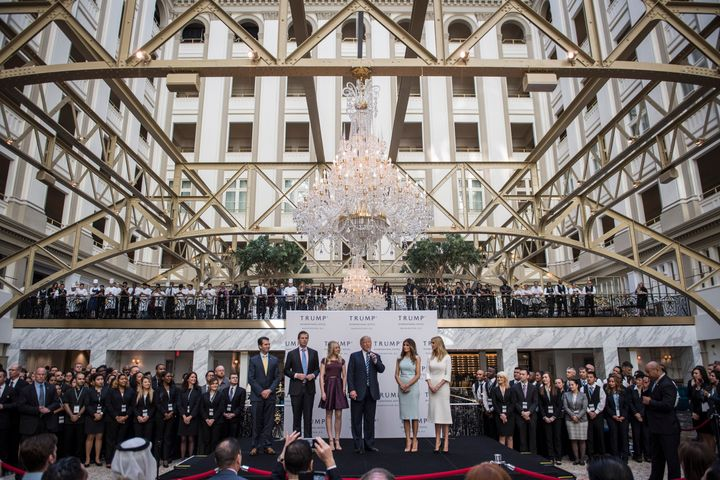 Republican presidential nominee Donald Trump and his adult children stage a ceremonial ribbon cutting for his new Washington,