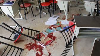 A picture shows the blood stained floor of a class room following rocket attacks carried out by Syrian rebels in the Shahba neighbourhood of the government-held side of Aleppo on October 27, 2016. At least six children were killed and 15 injured in the rebel attacks, Syrian state media said. The rocket fire in Aleppo hit two neighbourhoods in the west of the city, with one of the attacks striking a school. / AFP / GEORGE OURFALIAN        (Photo credit should read GEORGE OURFALIAN/AFP/Getty Images)