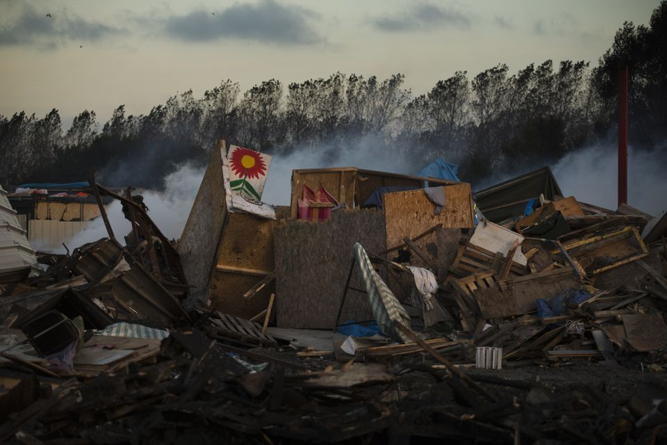 Tents destroyed are seen in the makeshift migrant camp known as the 'jungle' near Calais, northern