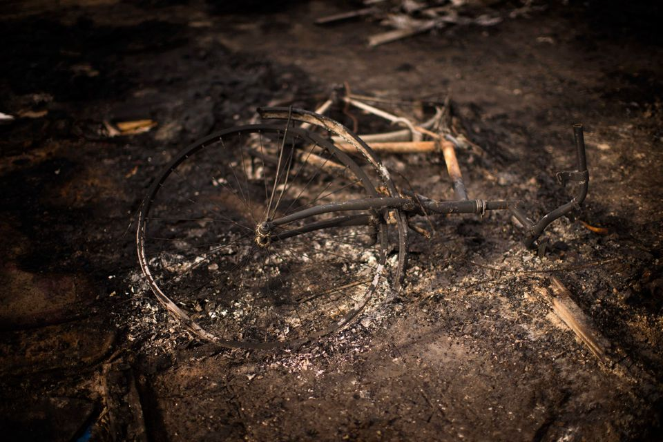 Aburnt bicycle remains on the floor of a charred