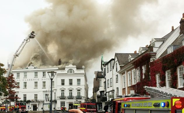 More than 100 firefighters are battling to save 'England's oldest hotel', the Royal Clarence Hotel in...