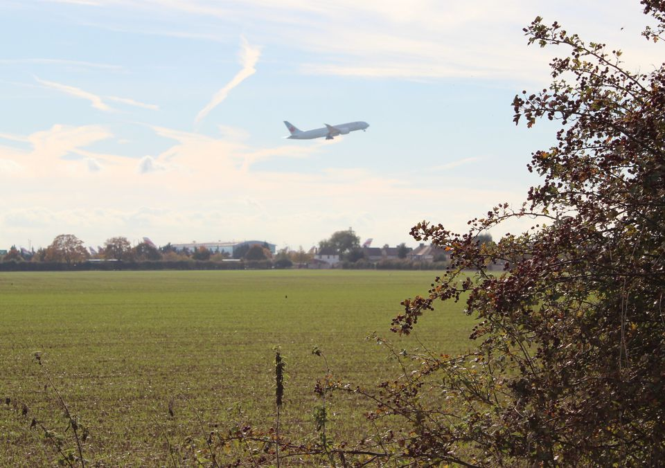 A plane ascends from the current northern runway at Heathrow over the village of Longford, near