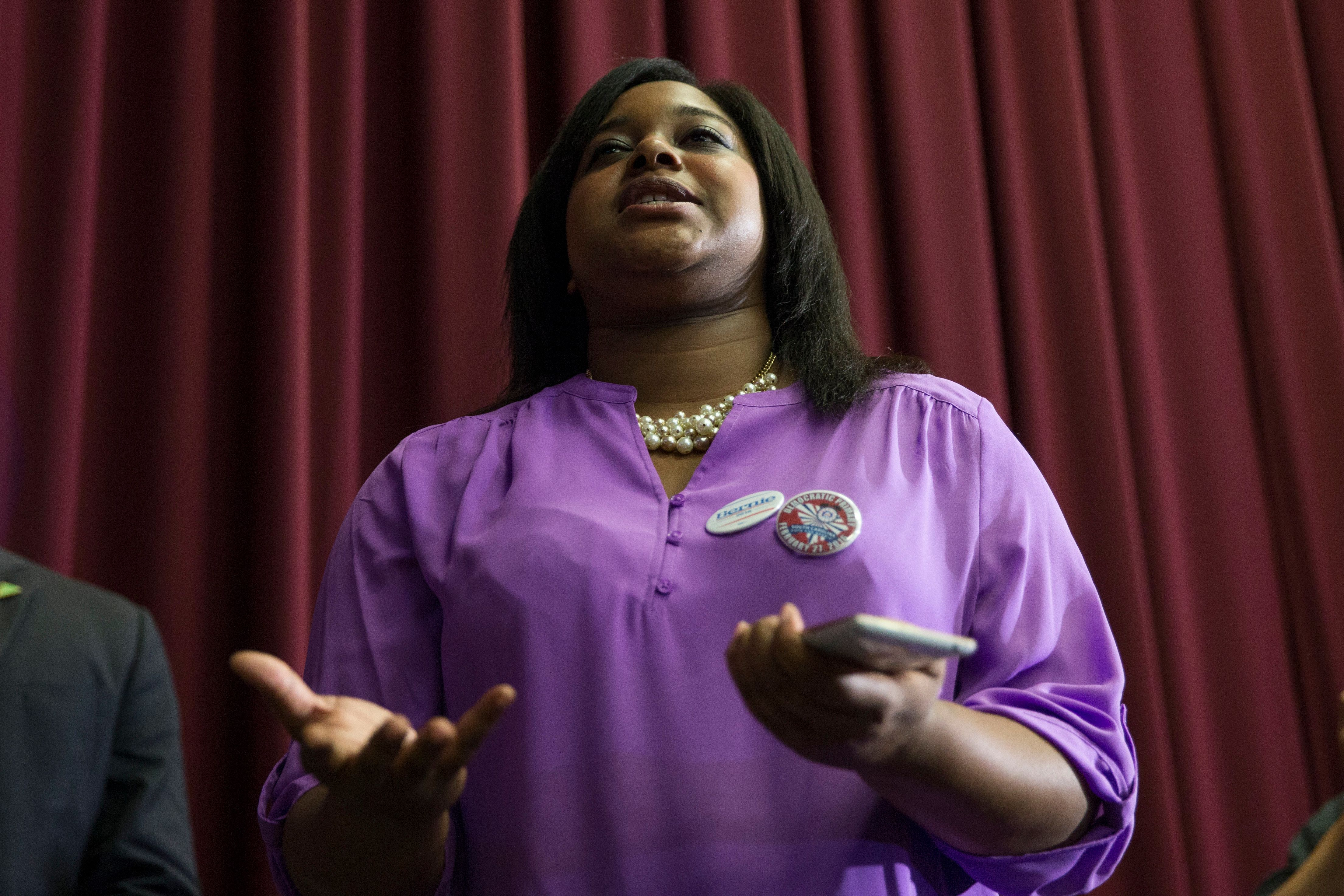 Erica Garner, daughter of Eric Garner, who was killed by New York City police, asks a question of Democratic presidential candidate Sen. Bernie Sanders, I-Vt., during a town hall at the University of South Carolina, on Tuesday, Feb. 16, 2016, in Columbia, S.C. (AP Photo/Evan Vucci)