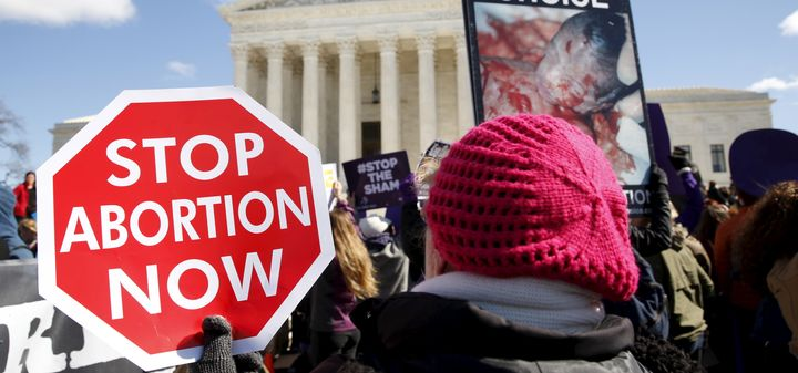 Protesters demonstrate in front of the U.S. Supreme Court on the morning that the court took up a major abortion case focusin