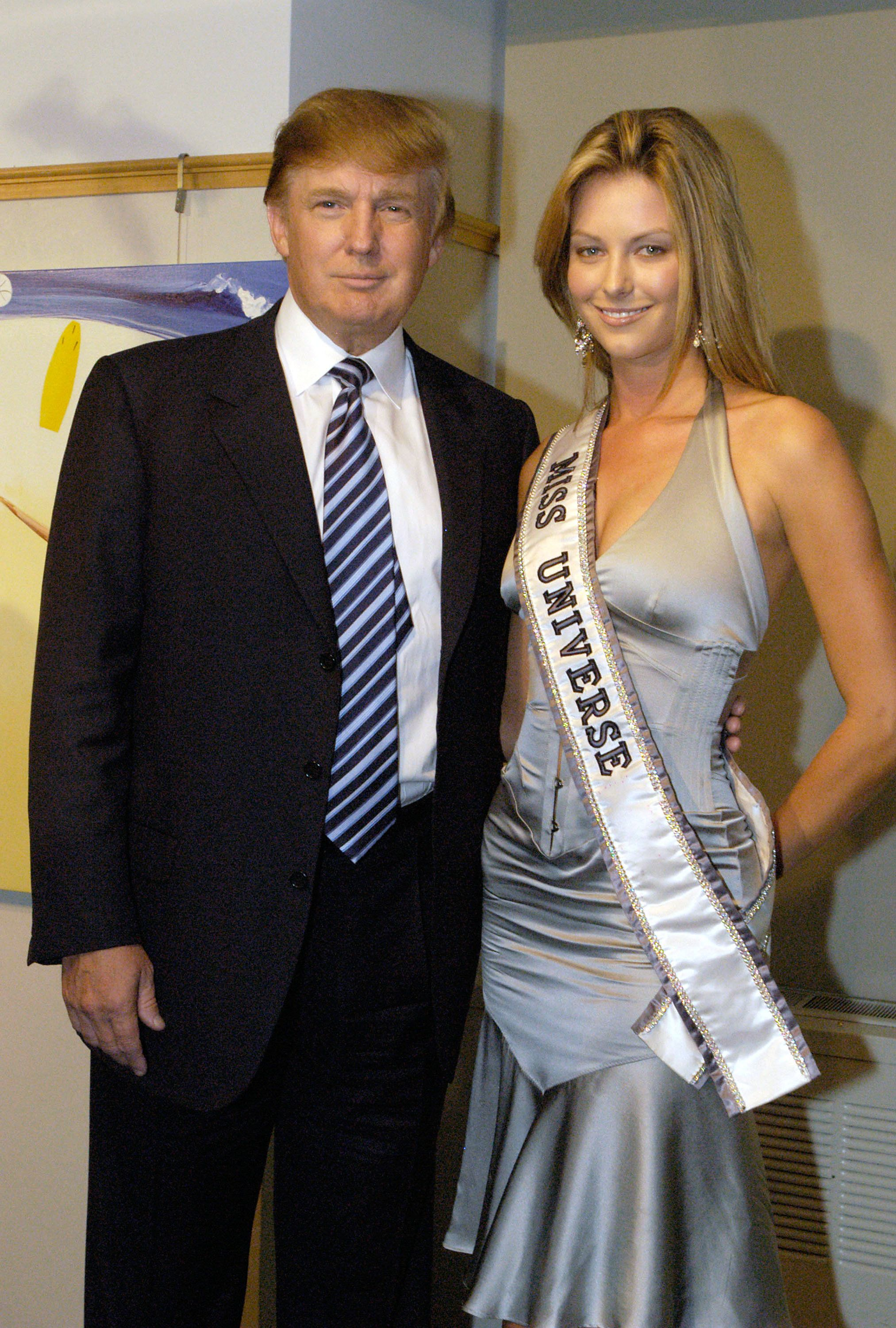 NEW YORK - JULY 28:  Donald Trump and Miss Universe Jennifer Hawkins pose for photographers at a cocktail party celebrating her crowning on July 28, 2004 in New York City. The party, hosted by the Hon. Ken Allen, Consul General of Australia was held at the Australian Consulate (Photo by Brownie Medina/Getty Images).