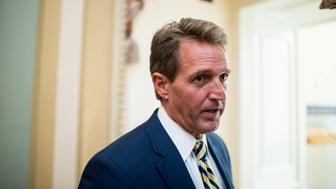 WASHINGTON, DC - MAY 12: Sen. Jeff Flake, R-Ariz., stops to speak with a reporter as he arrives for the Senate Republicans' policy luncheon on Tuesday, May 12, 2015. (Photo By Bill Clark/CQ Roll Call)