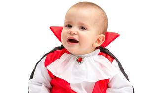 Little baby boy with Dracula costume isolated on white background