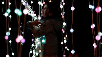A girl plays in the ocean of lights attraction during the Diwali lights switch on in Leicester, Britain October 16, 2016.  REUTERS/Darren Staples