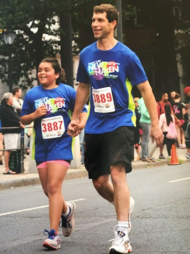 Josiah and his 11-year-old daughter at the finish line of a recent road