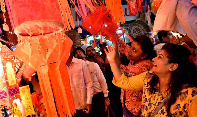 People buying Kandil (a colorful wall hanging specially used in Diwali) at a market near Crawford market...