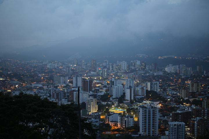 Pereira by night, nestled in the fog of the Andes Mountains