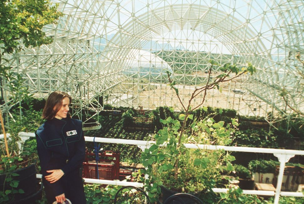 Abigail Alling stands on the balcony of the living quarters inside Biosphere 2 above the agricultural growing area of the com