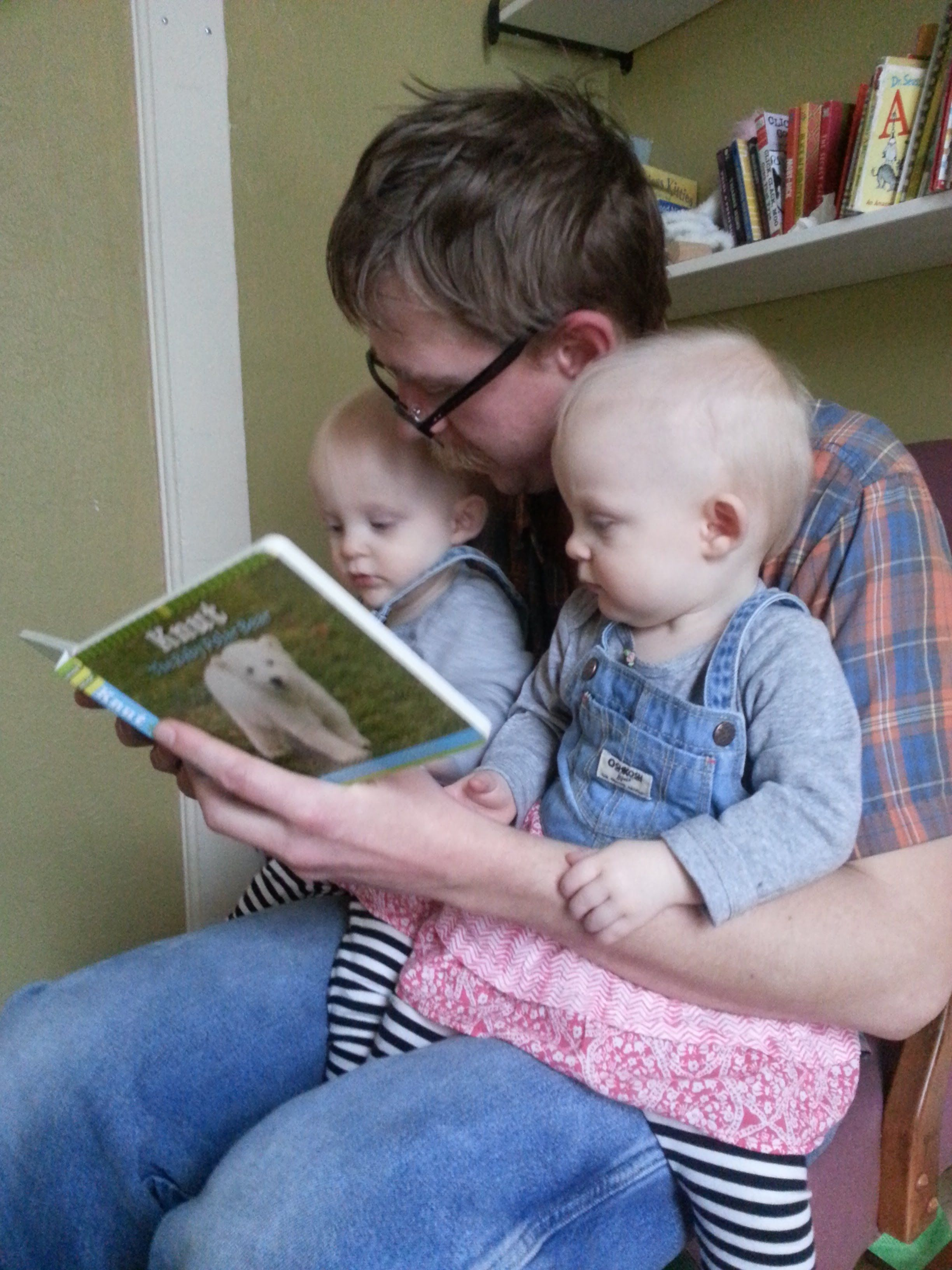 Sam reading to his daughters
