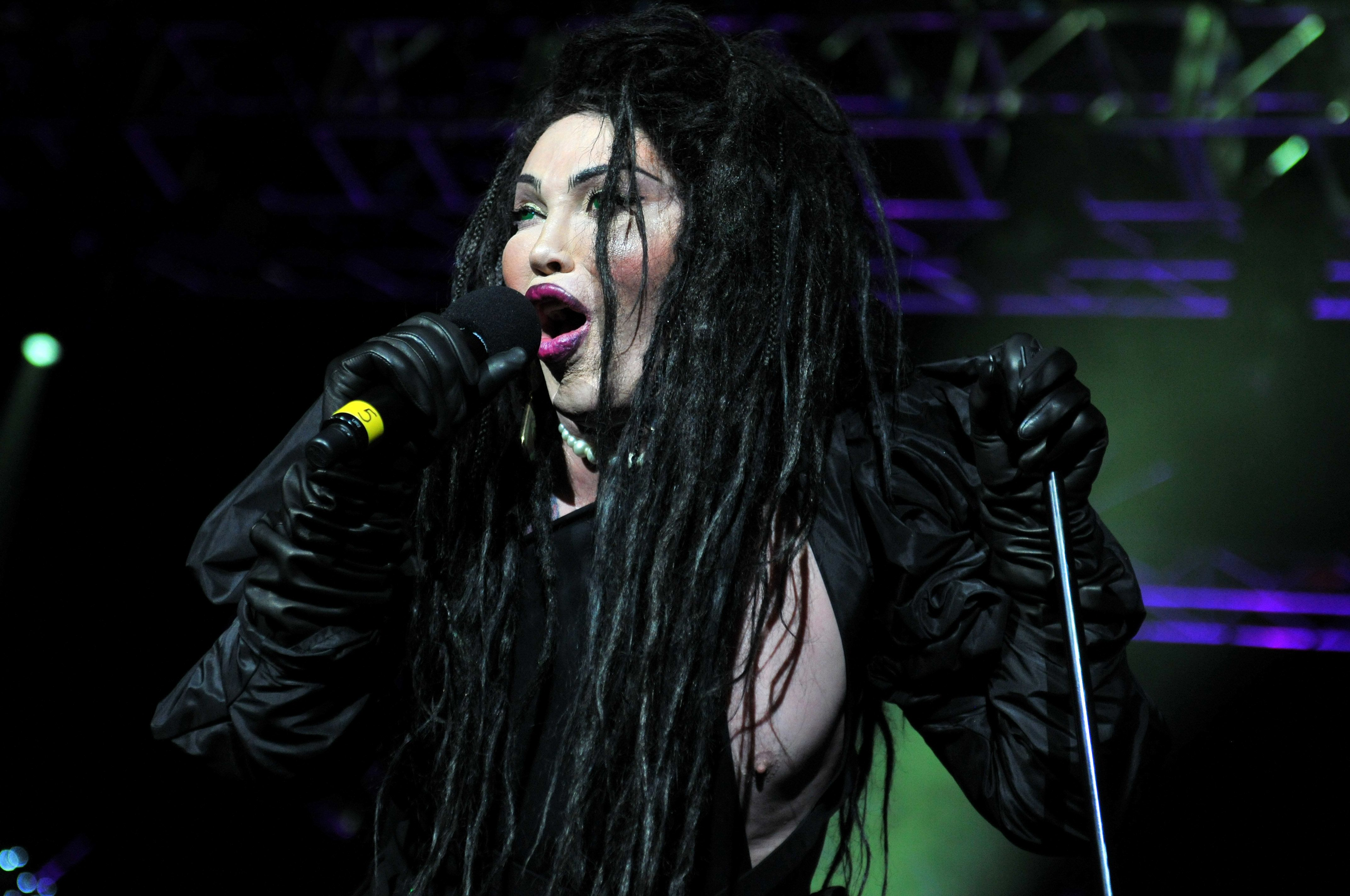 Pete Burns performing in
