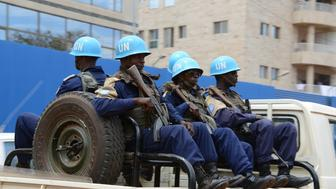 This photo taken on October 3, 2014 shows the UN Minusca peacekeepers patrolling through the 3rd district of Bangui, following deadly clashes between armed groups in the Central African town of Bambari that have left at least 25 dead, and increasing security on the eve of the Muslim feast of Eid al-Adha. The region remains highly restive due to splits within the Seleka 'between a branch that is more and more radicalised and another which is more open to dialogue to exit the crisis,' said Colonel Gilles Jaron of the French peacekeeping forces. AFP PHOTO / PACOME PABANDJI        (Photo credit should read PACOME PABANDJI/AFP/Getty Images)