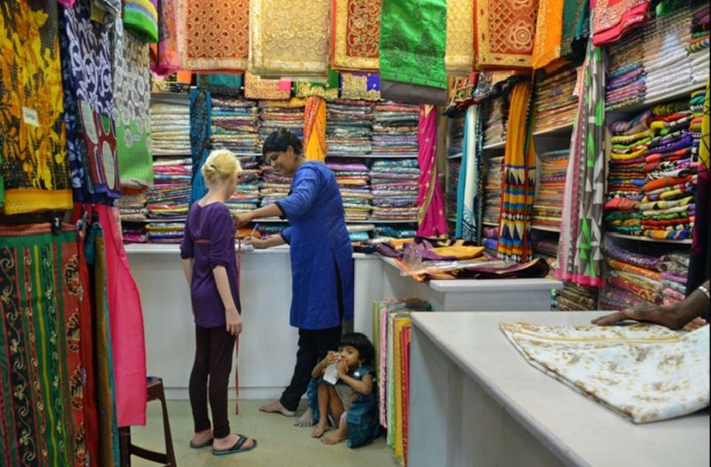 Getting fitted for a sari in Sri Lanka.