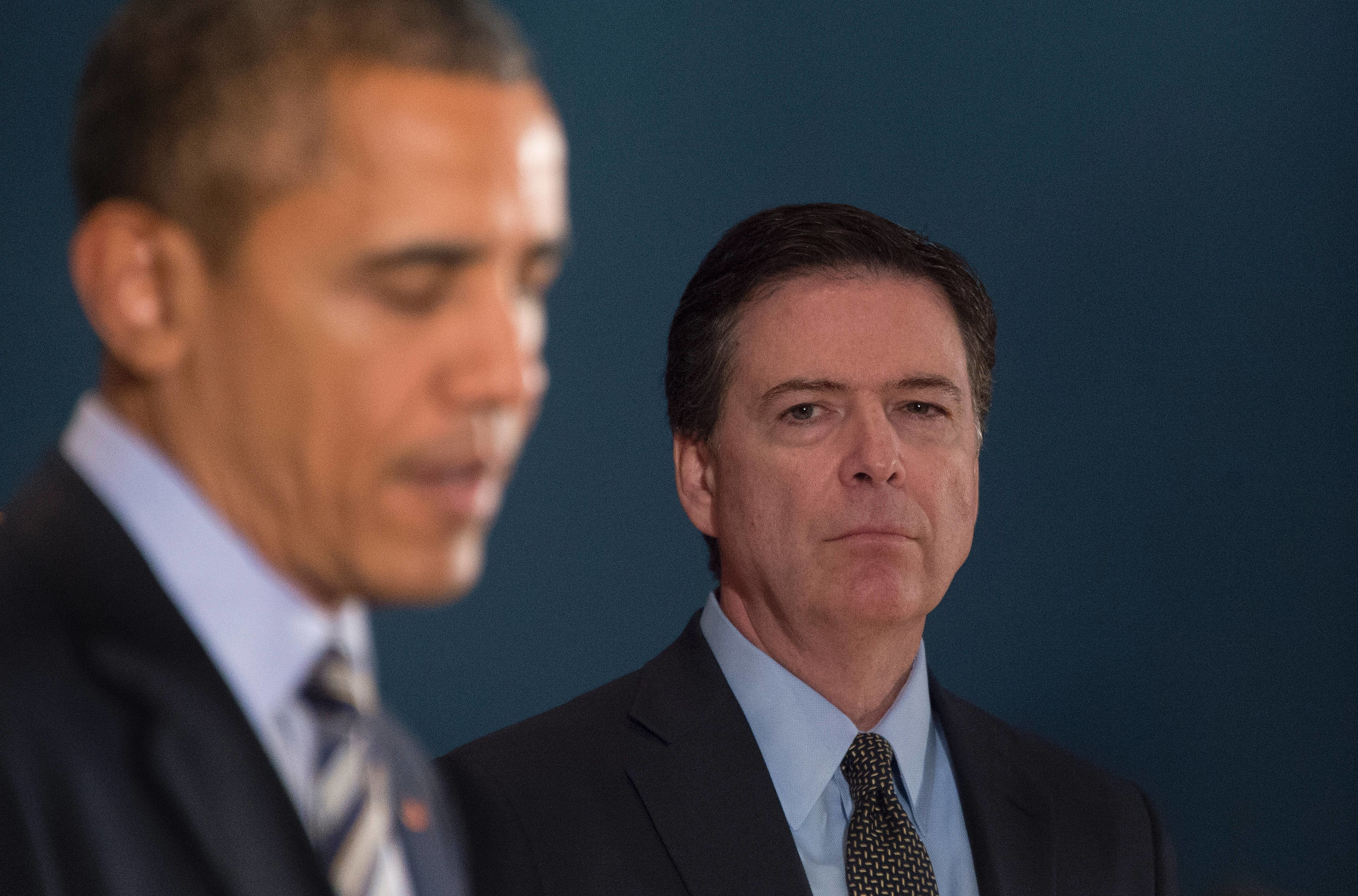 Director of the Federal Bureau of Investigations (FBI) James Comey (R) looks on as US President Barack Obama delivers remarks after a national security team meeting at the National Counterterrorism Center in McLean, Virginia, December 17, 2015. Obama said Thursday that there was no 'specific' terror threat to the United States but urged Americans to remain alert over the holiday period.  AFP PHOTO / JIM WATSON / AFP / JIM WATSON        (Photo credit should read JIM WATSON/AFP/Getty Images)