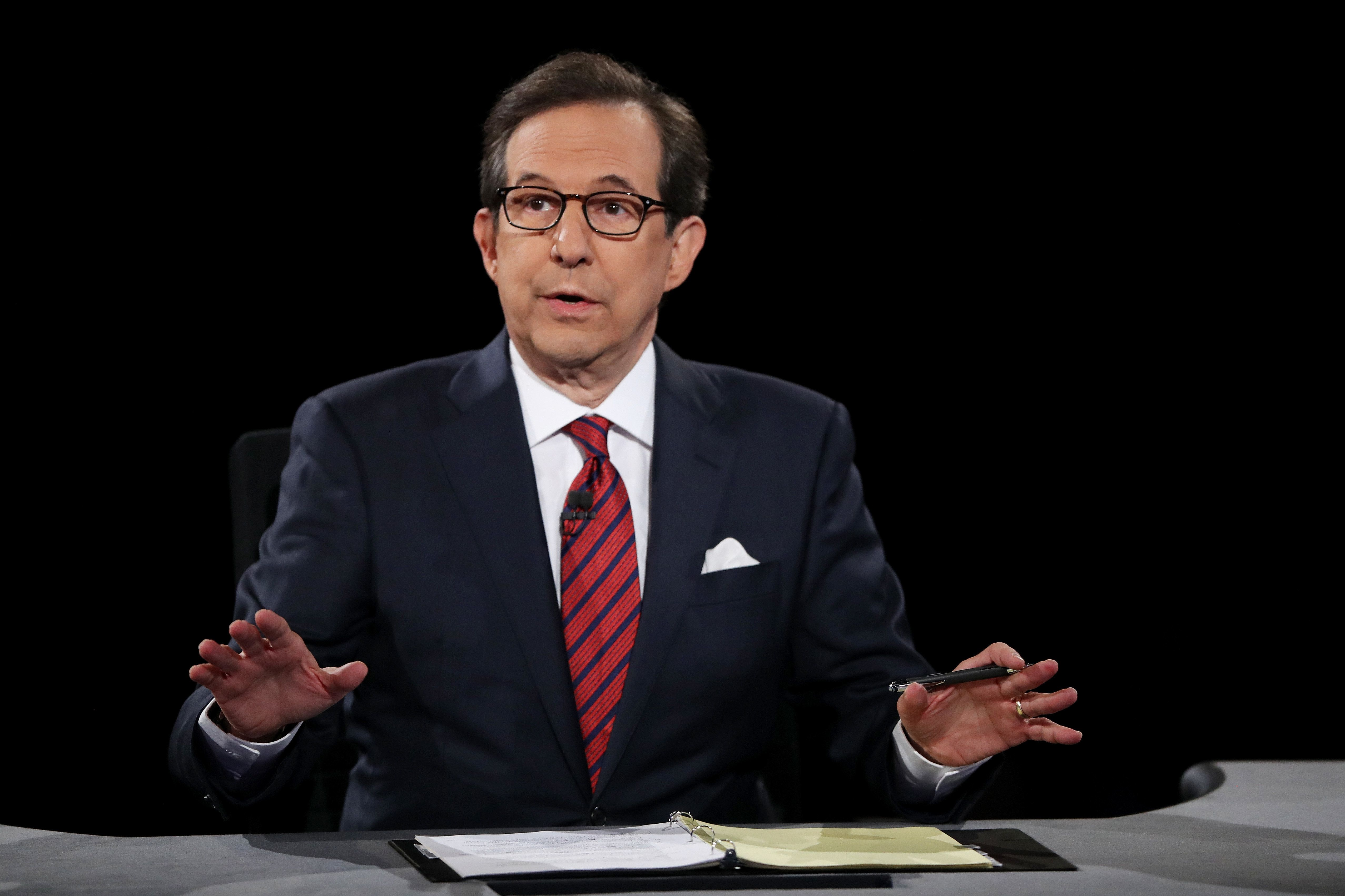 LAS VEGAS, NV - OCTOBER 19:  Fox News anchor and moderator Chris Wallace asks the candidates a question during the third U.S. presidential debate at the Thomas & Mack Center on October 19, 2016 in Las Vegas, Nevada. Tonight is the final debate ahead of Election Day on November 8.  (Photo by Joe Raedle/Getty Images)