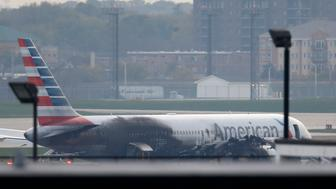 Soot covers the fuselage of an American Airlines jet that blew a tire, sparking a fire and prompting the pilot to abort takeoff before passengers were evacuated from the plane via emergency chute, at O'Hare International Airport in Chicago, Illinois, U.S.October 28, 2016.  REUTERS/Jim Young   TPX IMAGES OF THE DAY