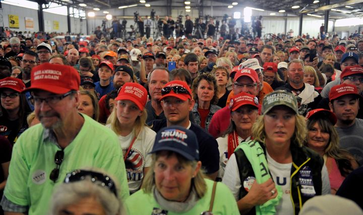 Supporters of Republican Presidential nominee Donald Trump listen as he addresses a capacity crowd at the Jefferson County Fa
