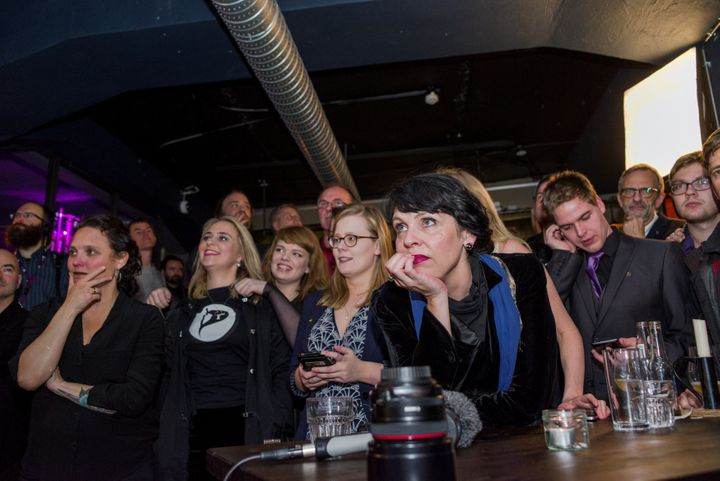 Birgitta Jonsdottir of the Pirate Party is seen alongisde party members after parliamentary elections in Iceland, October 29,