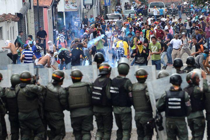 Demonstrators clash with members of Venezuelan National Guard during a rally demanding a referendum to remove Venezuela's Pre