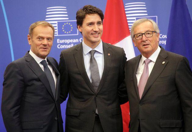 European Commission President Jean-Claude Juncker, right, European Council President Donald Tusk, left,...