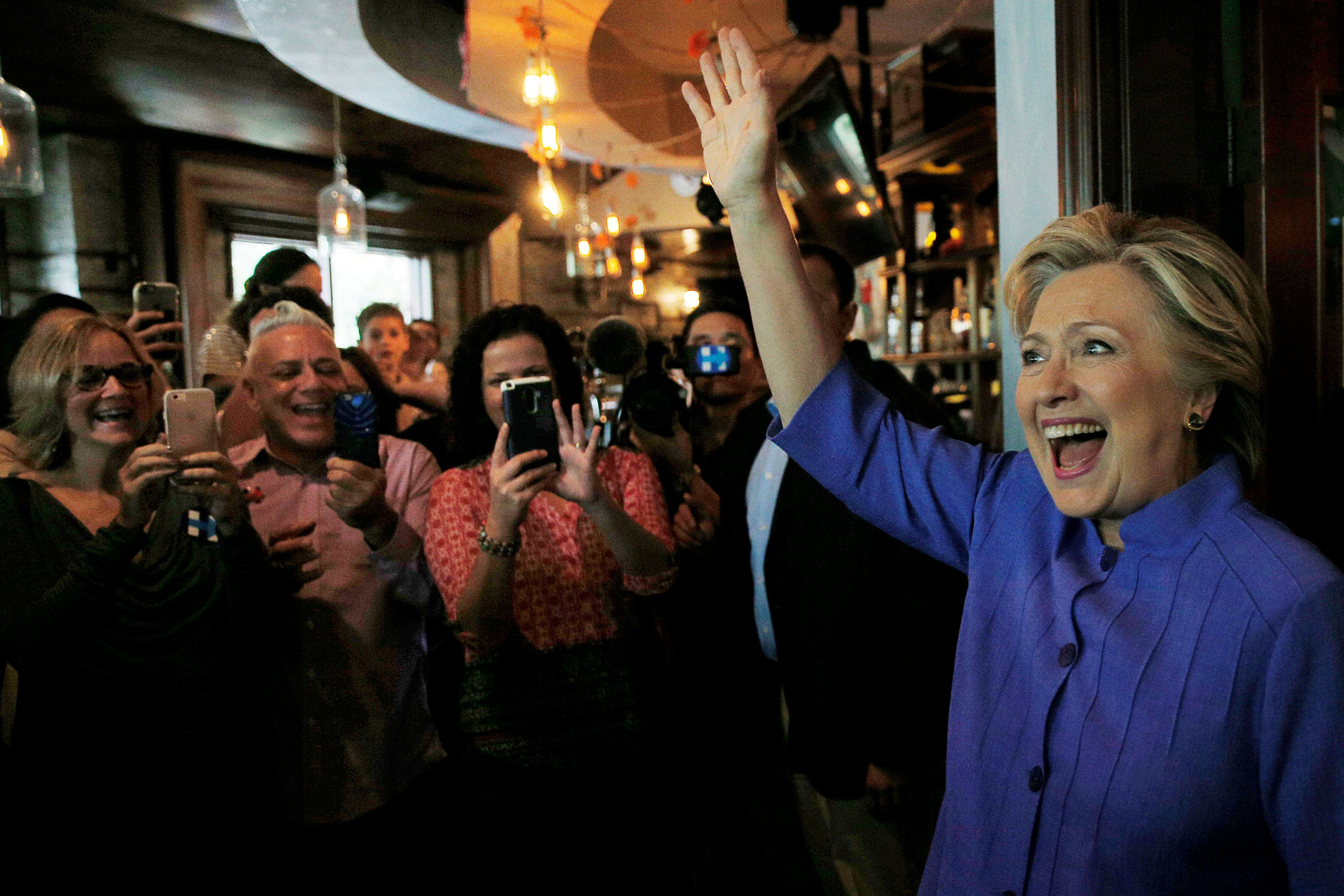 U.S. Democratic presidential nominee Hillary Clinton greets voters at an early voting brunch at Fado's Irish Pub in Miami, Florida, U.S. October 30, 2016.  REUTERS/Brian Snyder