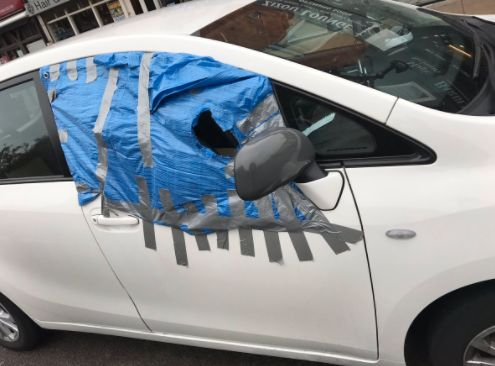 Car With Amazing Patched-Up 'Peephole' Window Was Unsurprisingly Pulled Over By