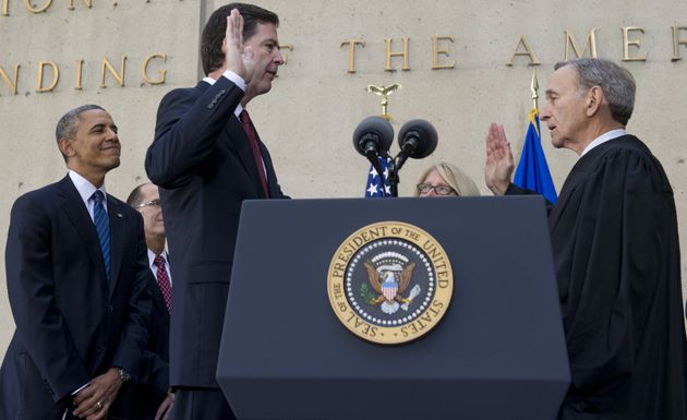 President Barack Obama looks on as James Comey is sworn inas the FBI director in a ceremony on...