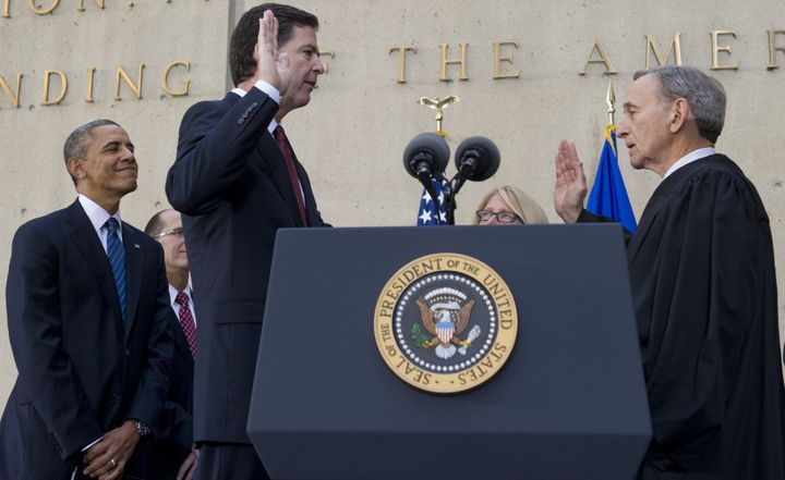 President Barack Obama looks on as James Comey is sworn inas the FBI director in a ceremony on Oct. 28, 2013.