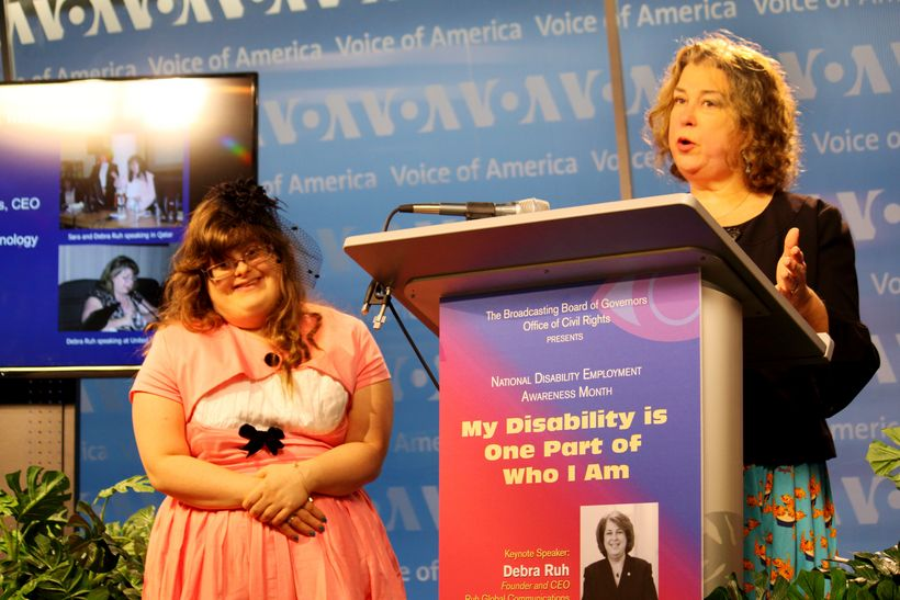 Sara Ruh with Debra Ruh photographed Speaking at the Voice of America During National Disability Employment Awareness Month 2