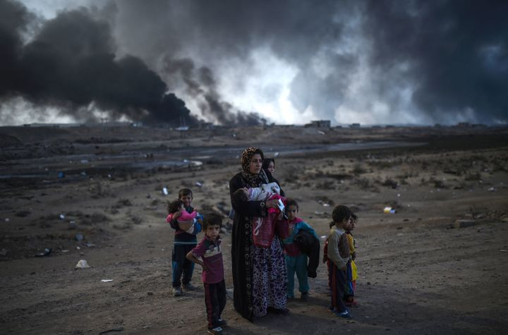 Iraqi families displaced by the US-backed and Iraqi-led operation against the Islamic State group to retake Mosul are seen ne