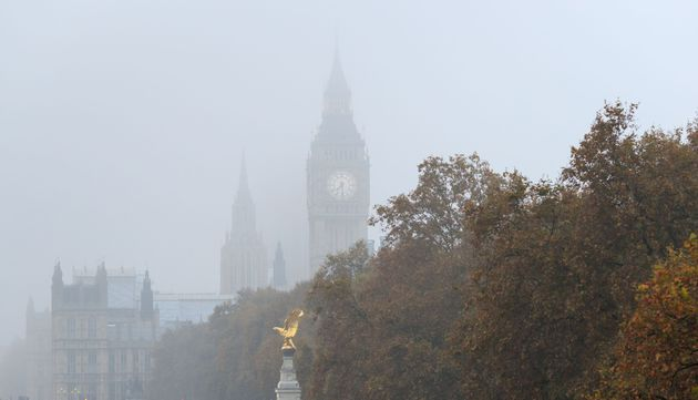 Big Ben peeking through thick