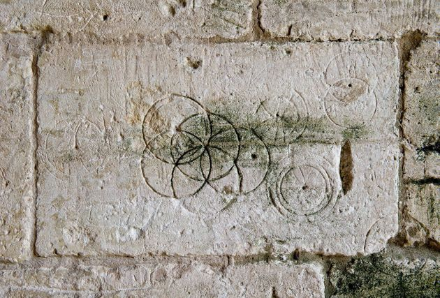 Daisy wheels inscribed with a pair of compasses or dividers found in Saxon Tithe Barn,