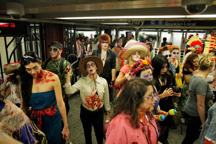 """People dressed like zombies swarm a New York City subway during an annual """"ZOMBIECON"""" event. The Big Apple ranked last for sa"""