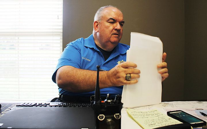 Major C.J. Destor works in his office at the St. John the Baptist Sheriff's office in LaPlace, Louisiana, on Oct. 20.