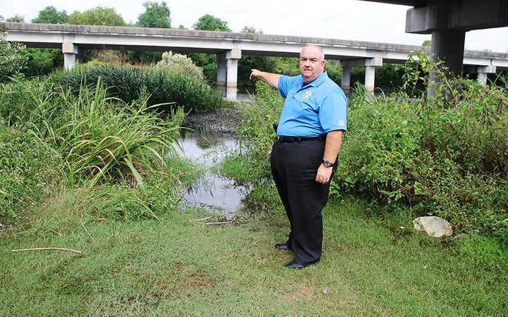 St. John the Baptist Sheriff's Office Major C.J. Destor points to where Karen Ivester's body was found in LaPlace, Louisiana.