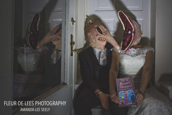 """Sarah and Steve's 'Beetlejuice' wedding photo."" -- <i>Amanda Seely</i>"