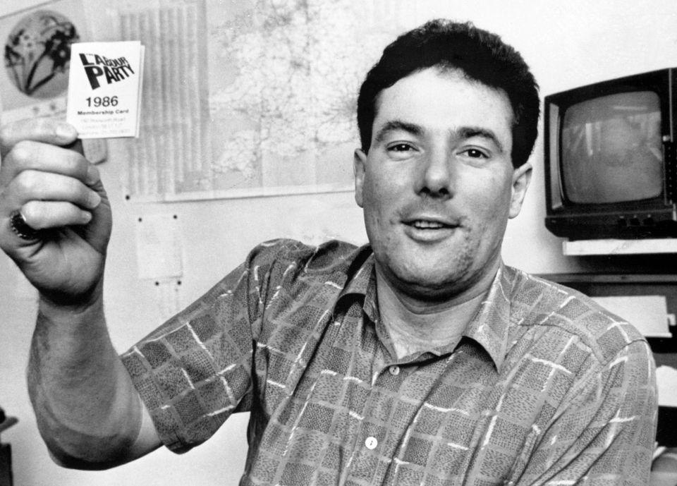 Derek Hatton shows his 1986 Labour membership card after being