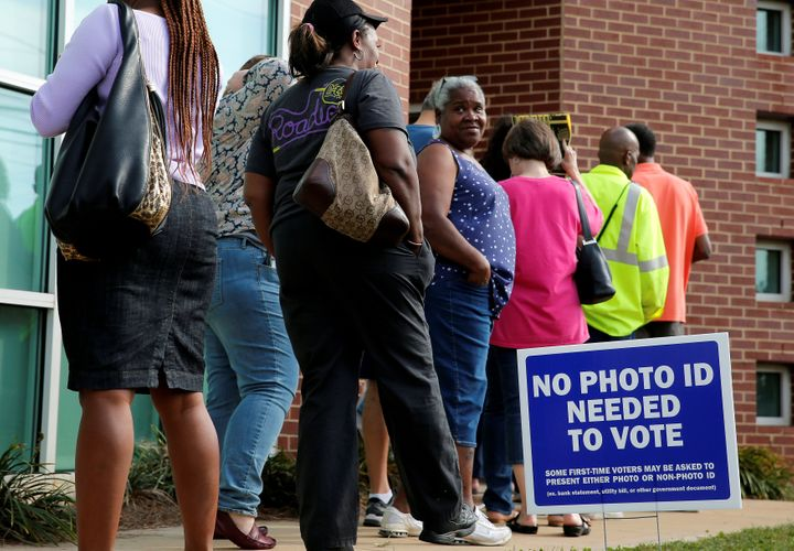 Voters stand in line during early voting at the Beatties Ford Library in Charlotte, North Carolina.