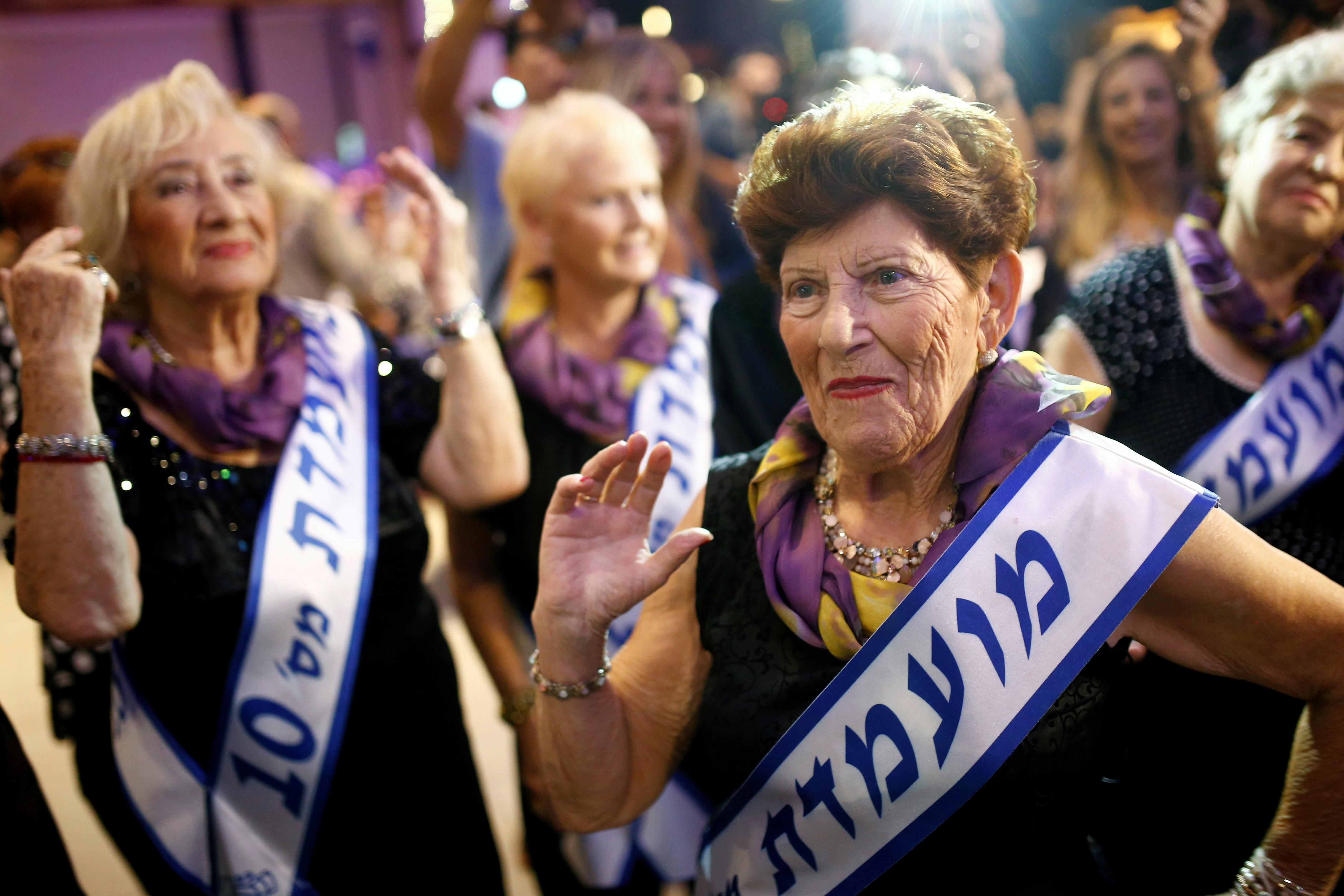 Holocaust survivor, Carmela Ben Yehuda, 89, dances during the annual Holocaust survivors' beauty pageant in the Israeli city